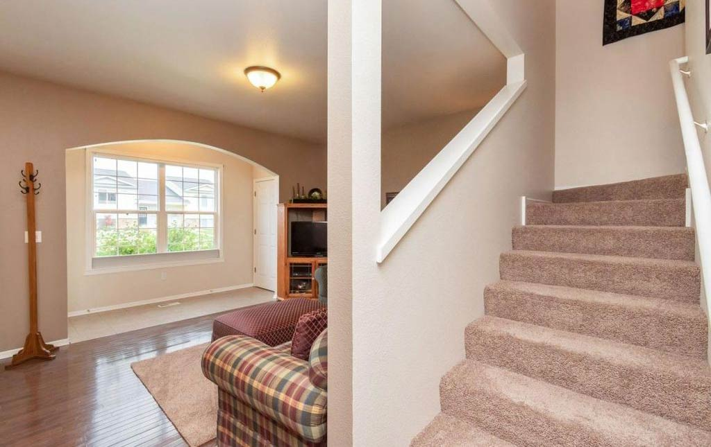 3838 Marigold - Rental Home - living room and stairs
