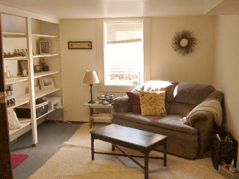 234 S. Franklin - Bonus living space with couch and built in shelving